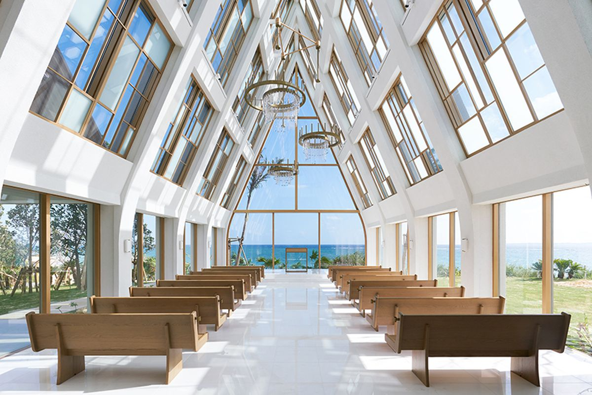 Modern japanese chapel by the beach is all windows curbed for Design hotel okinawa
