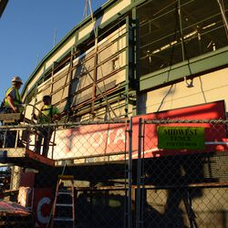 4:10 p.m. The last segment of the marquee being lowered onto the flatbed truck -