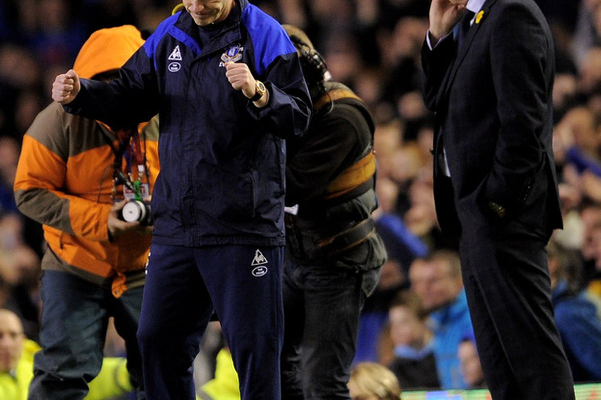 Everton manager David Moyes celebrates after beating Tottenham Hotspur, while Harry Redknapp looks quite bemused.  (Photo by Michael Regan/Getty Images)