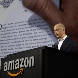 Jeff Bezos, CEO and founder of Amazon, demonstrates a Kindle paperwhite tablet at the introduction of the new Amazon Kindle Fire HD and Kindle Paperwhite in Santa Monica, Calif., Thursday, Sept. 6, 2012.