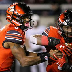 Utah Utes quarterback Troy Williams (3) hands the ball off to running back Zack Moss (2) at Rice-Eccles Stadium in Salt Lake City on Saturday, Nov. 25, 2017.