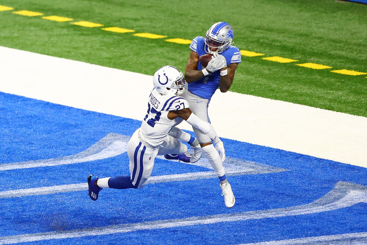 Marvin Jones #11 of the Detroit Lions catches a 4-yard touchdown pass around Xavier Rhodes #27 of the Indianapolis Colts during the fourth quarter at Ford Field on November 01, 2020 in Detroit, Michigan.