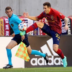 Real Salt Lake defender Aaron Herrera (22) stops the ball as it crosses over to him as Real Salt Lake and Vancouver FC play at Rio Tinto Stadium in Sandy on Wednesday, July 7, 2021.