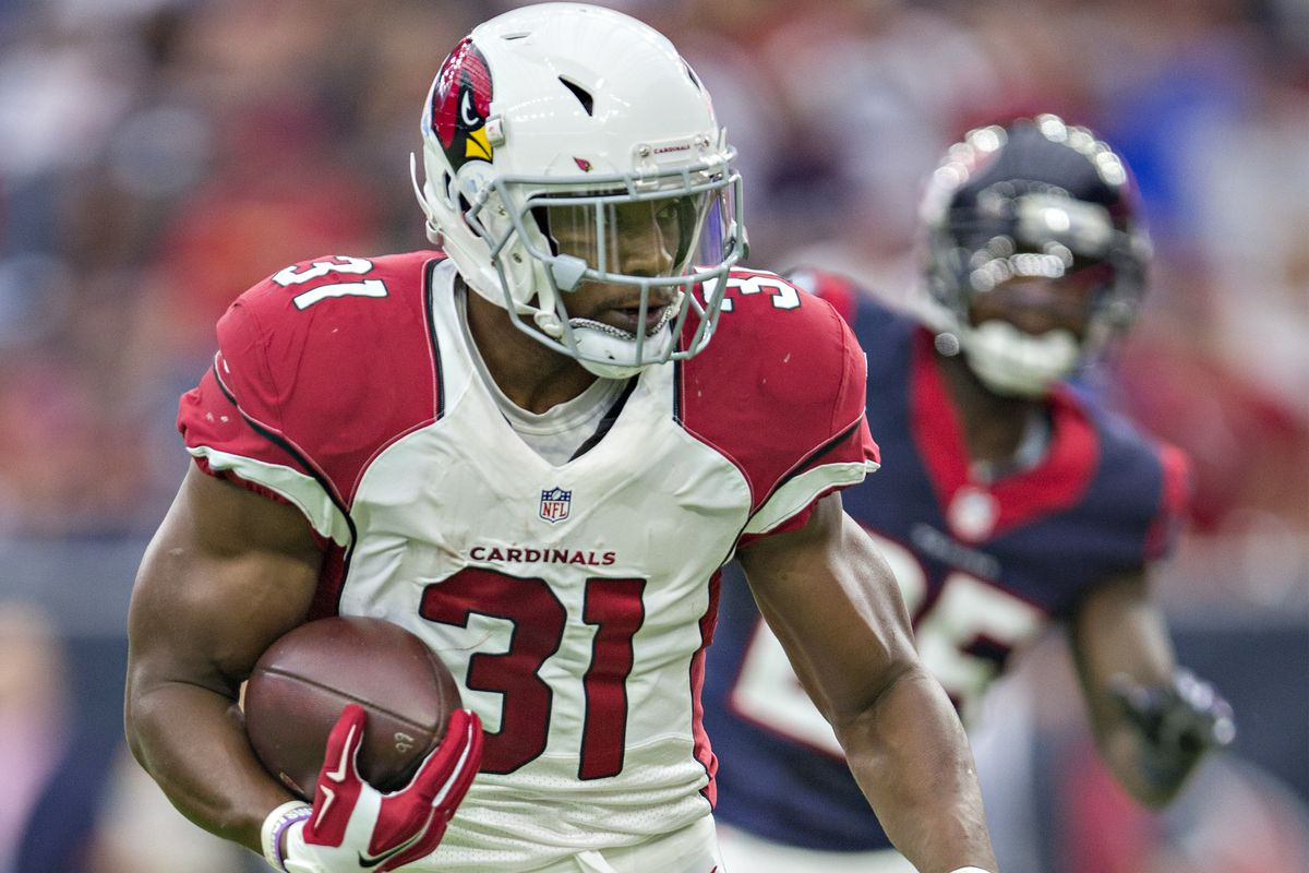 David Johnson of the Arizona Cardinals runs the ball during a preseason game against the Houston Texans at NRG Stadium on August 28, 2016 in Houston, Texas. The Texans defeated the Cardinals 34-24.