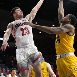 Arizona guard Alex Barcello lays in a soft layup past Cal's Jacobi Gordon, right, during the Arizona-Cal game in McKale Center on February 21 in Tucson, Ariz.