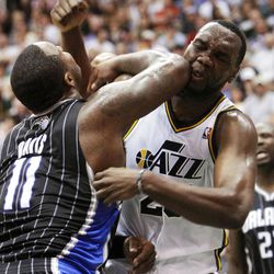 Utah Jazz center Al Jefferson (25) catches an elbow from Orlando's #11 Glen Davis as the Utah Jazz and the Orlando Magic play Saturday, April 21, 2012 in Energy Solutions arena.