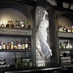 An albino peacock oversees the bar.