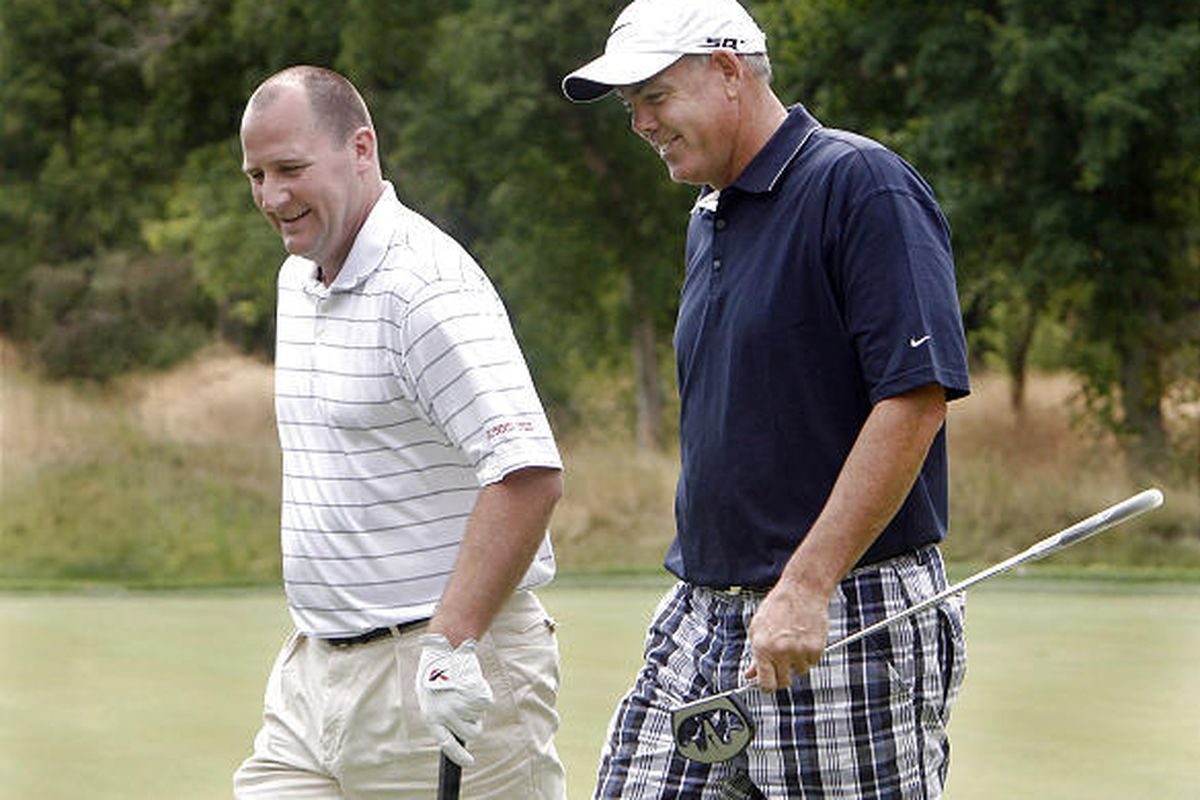 Utah basketball coach Jim Boylan, left, chats with BYU basketball coach Dave Rose as they walk off a green during a golf charity event for the Huntsman Cancer Institute at the Salt Lake County Club. Rose is in remission after a pancreatic cancer scare.