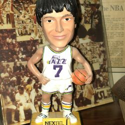 """Former Utah Jazz coach Frank Layden keeps a rare """"Pistol Pete"""" Maravich promotional toy among his personal items."""