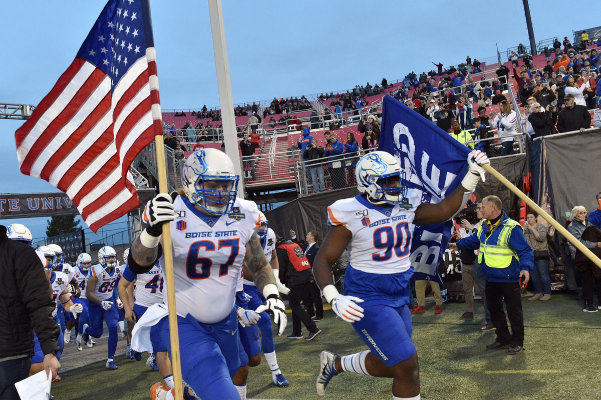 Garrett Larson and Scale Igiehon of the Boise State Broncos run on to the field before the team's game against the Washington Huskies during the Mitsubishi Motors Las Vegas Bowl at Sam Boyd Stadium on December 21, 2019 in Las Vegas, Nevada.
