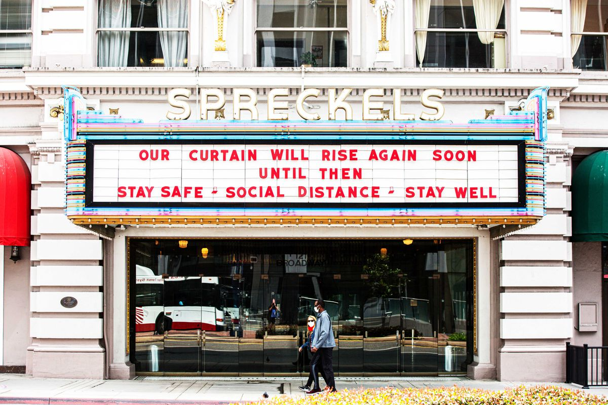 """A movie theater marquee reads """"Our curtain will rise again soon. Until then, stay safe, socially distance, stay well."""""""