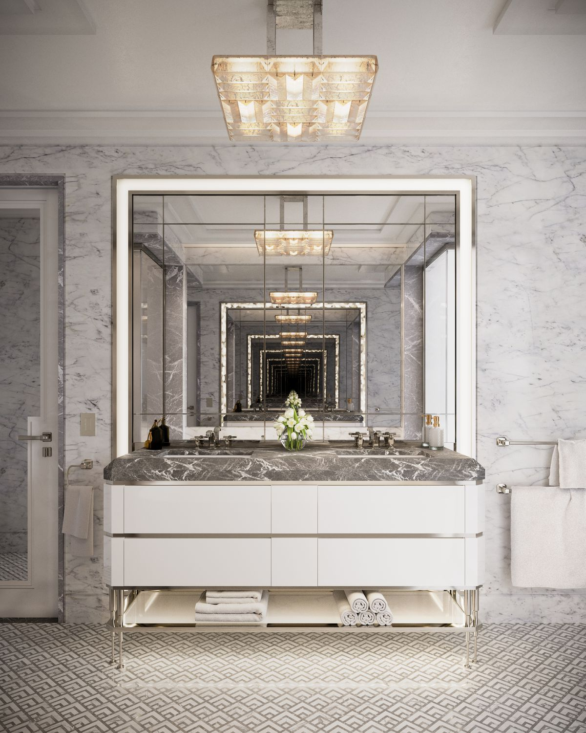 A bathroom with a large mirror and marble finishes.