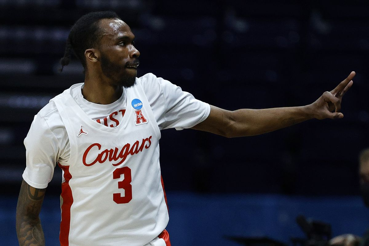 DeJon Jarreau of the Houston Cougars celebrates a three point basket against the Oregon State Beavers during the first half in the Elite Eight round of the 2021 NCAA Men's Basketball Tournament at Lucas Oil Stadium on March 29, 2021 in Indianapolis, Indiana.