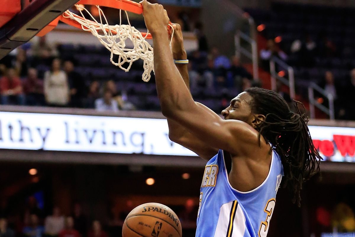 Kenneth Faried flushes down a jam with authority