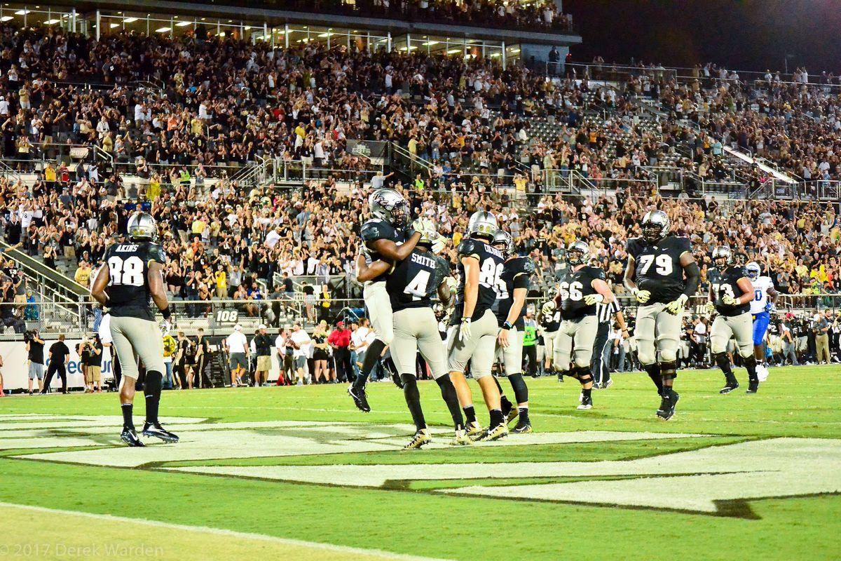UCF receiver Tre'Quan Smith celebrates a touchdown reception against Memphis. (Photo: Derek Warden)