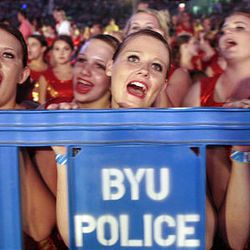 Fans cheer as pop music stars the Jonas Brothers perform at the 2009 Stadium of Fire at LaVell Edwards Stadium in Provo on Saturday.