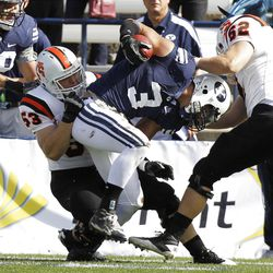 Brigham Young Cougars linebacker Kyle Van Noy returns a blocked punt as Brigham Young University faces Idaho State in NCAA football in Provo, Saturday, Oct. 22, 2011.