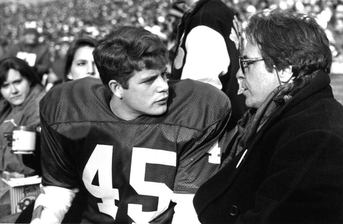Sean Astin and David Anspaugh on the set of 'Rudy'