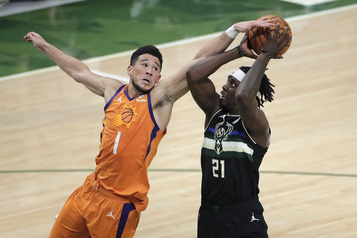 Devin Booker and  Jrue Holiday have gone from NBA Finals foes to Tokyo Olympic teammates.
