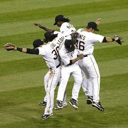 Pirates players celebrate Thursday's come-from-behind victory over the Phillies.