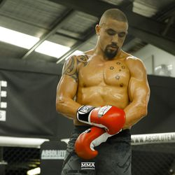 Robert Whittaker ends his striking portion of his UFC 234 media workout.