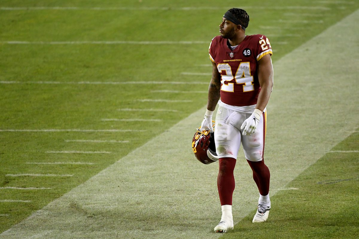 Antonio Gibson #24 of the Washington Football Team walks off the field after the game against the Carolina Panthers at FedExField on December 27, 2020 in Landover, Maryland.
