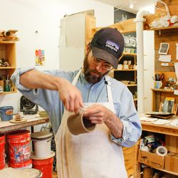 Jeremy Ogusky at work in his studio.