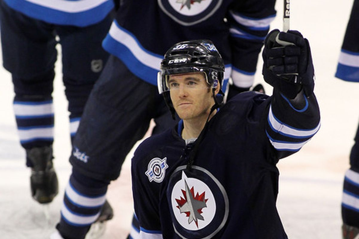 WINNIPEG, CANADA - DECEMBER 31: Mark Flood #36 of the Winnipeg Jets salutes the fans after they defeated the Toronto Maple Leafs in NHL action at the MTS Centre on December 31, 2011 in Winnipeg, Manitoba, Canada. (Photo by Marianne Helm/Getty Images)