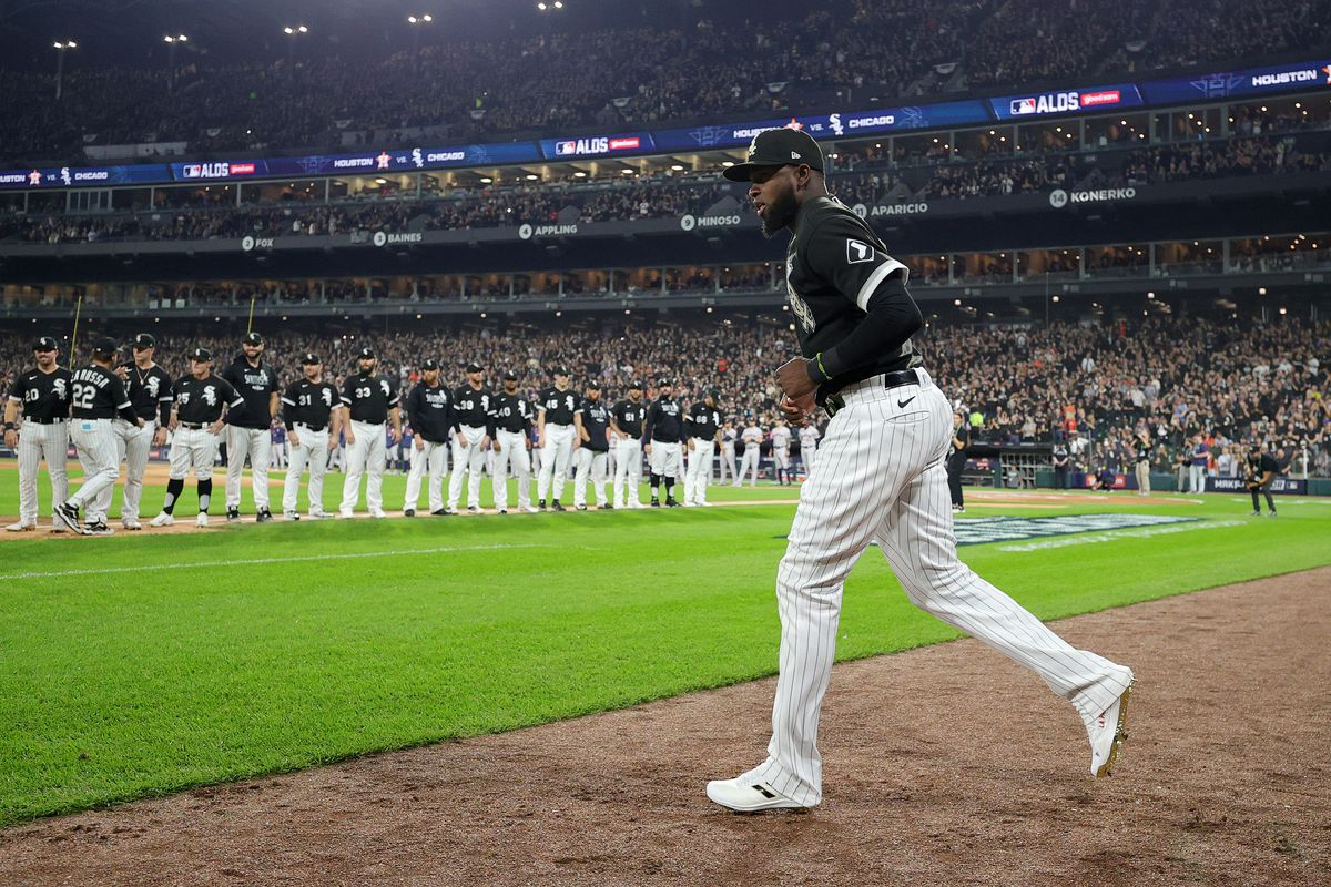 The White Sox' Luis Robert runs onto the field during pregame ceremonies Sunday.