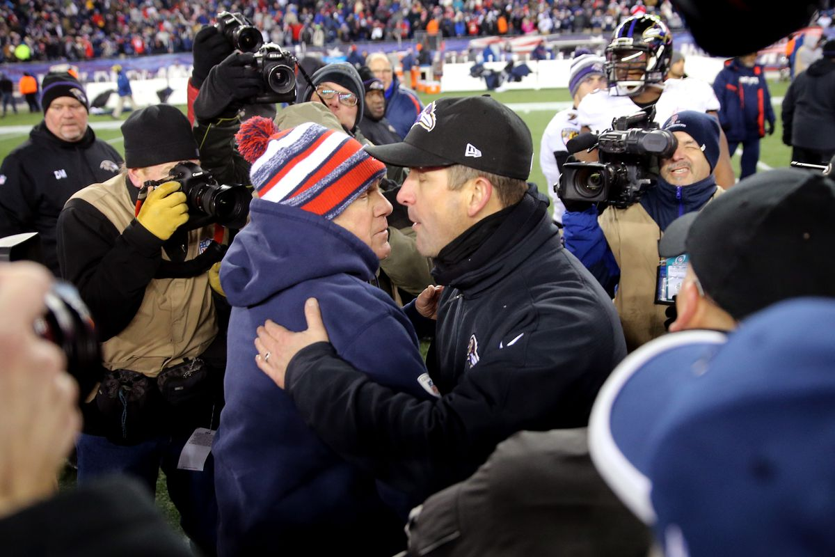 Head coaces Bill Belichick of the New England Patriots and John Harbaugh of the Baltimore Ravens shake hands following the 2015 AFC Divisional Playoffs game at Gillette Stadium on January 10, 2015 in Foxboro, Massachusetts.