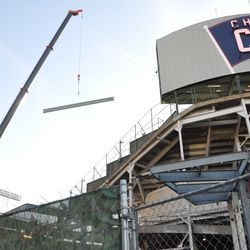 A steel beam being lowered into the right-center field bleachers -