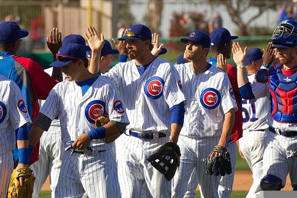 Chicago Cubs players celebrate after their 11-4 victory against the Colorado Rockies at HoHoKam Park. Credit: Allan Henry-US PRESSWIRE