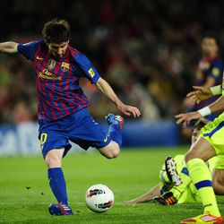 FC Barcelona's Lionel Messi, from Argentina, scores against Getafe during a Spanish La Liga soccer match at the Camp Nou stadium in Barcelona, Spain, Tuesday, April 10, 2012.