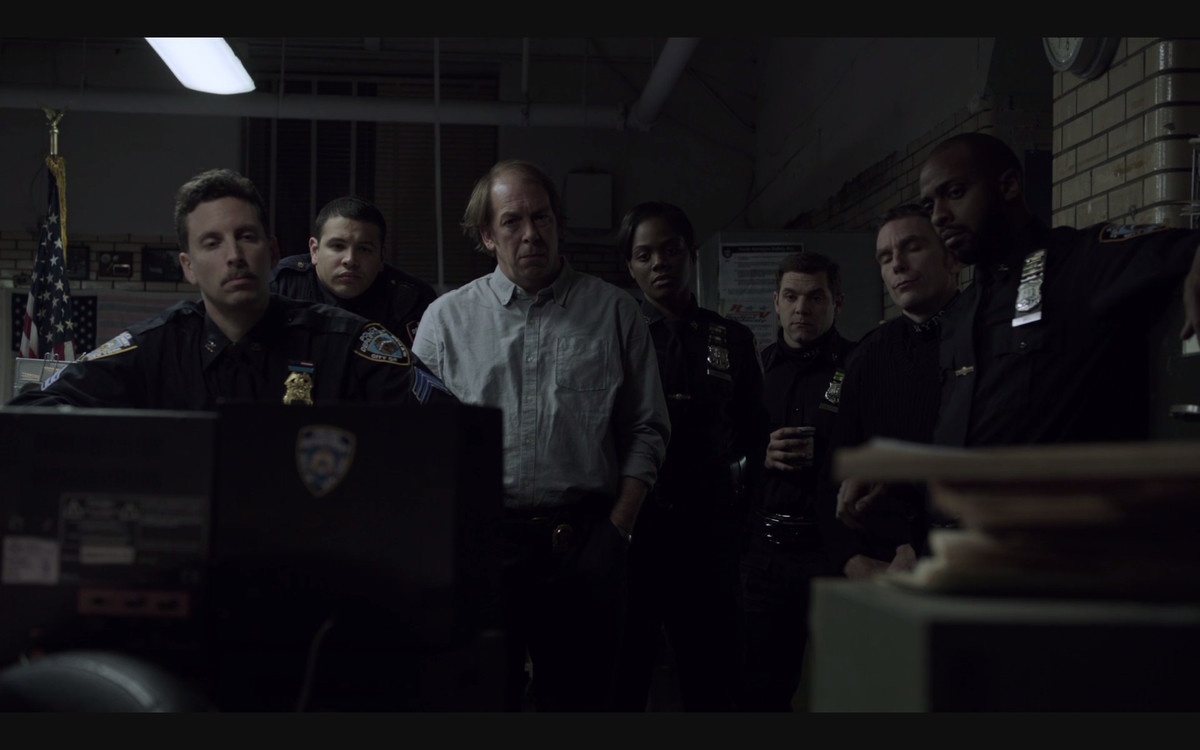 A scene featuring a group of police officers in The Night Of