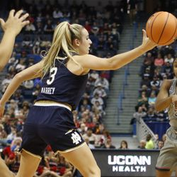 UConn's Crystal Dangerfield (5) gets a pass by the arm of Notre Dame's Marina Mabrey (3) during the Notre Dame Fighting Irish vs UConn Huskies women's college basketball game in the Women's Jimmy V Classic at the XL Center in Hartford, CT on December 3, 2017.