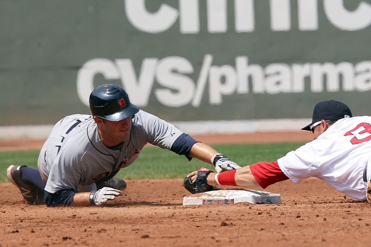 BOSTON, MA - MAY 28:  Danny Worth #29 of the Detroit Tigers is tagged out at second by Mike Aviles #3 of the Boston Red Sox in the second inning at Fenway Park May 28, 2012  in Boston, Massachusetts. (Photo by Jim Rogash/Getty Images)