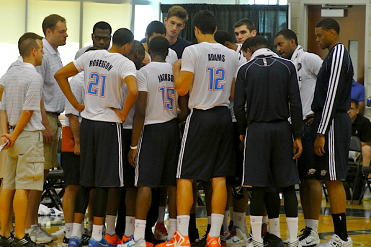 The Thunder huddle up in game three of the Orlando Summer League