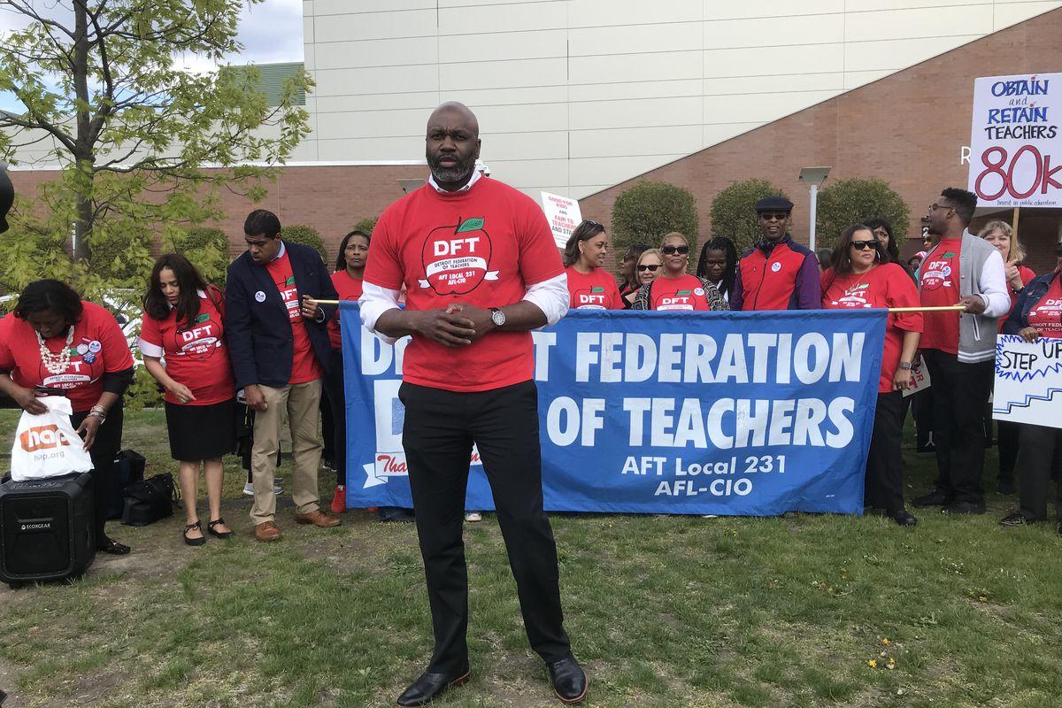 Terrence Martin, president of the Detroit Federation of Teachers, speaks during a demonstration outside Renaissance High School