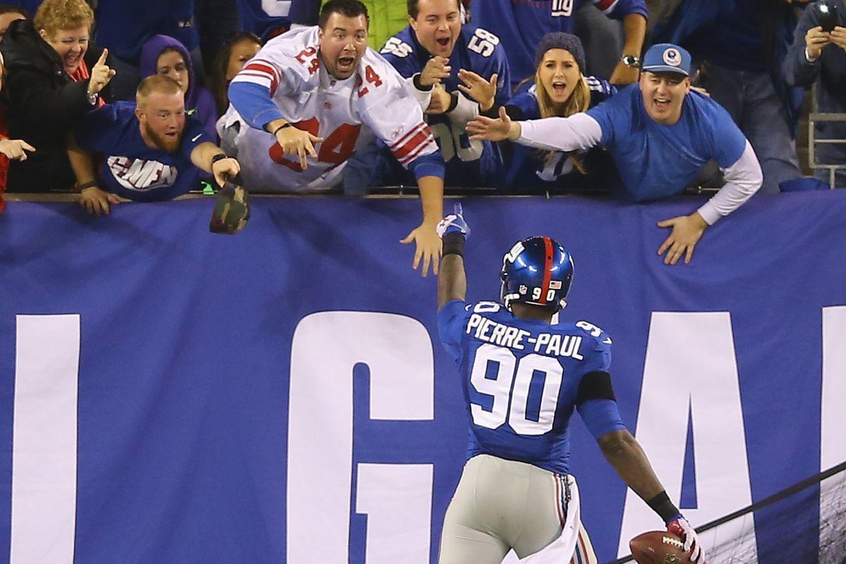 Jason Pierre-Paul celebrates his fourth-quarter touchdown with Giants' fans