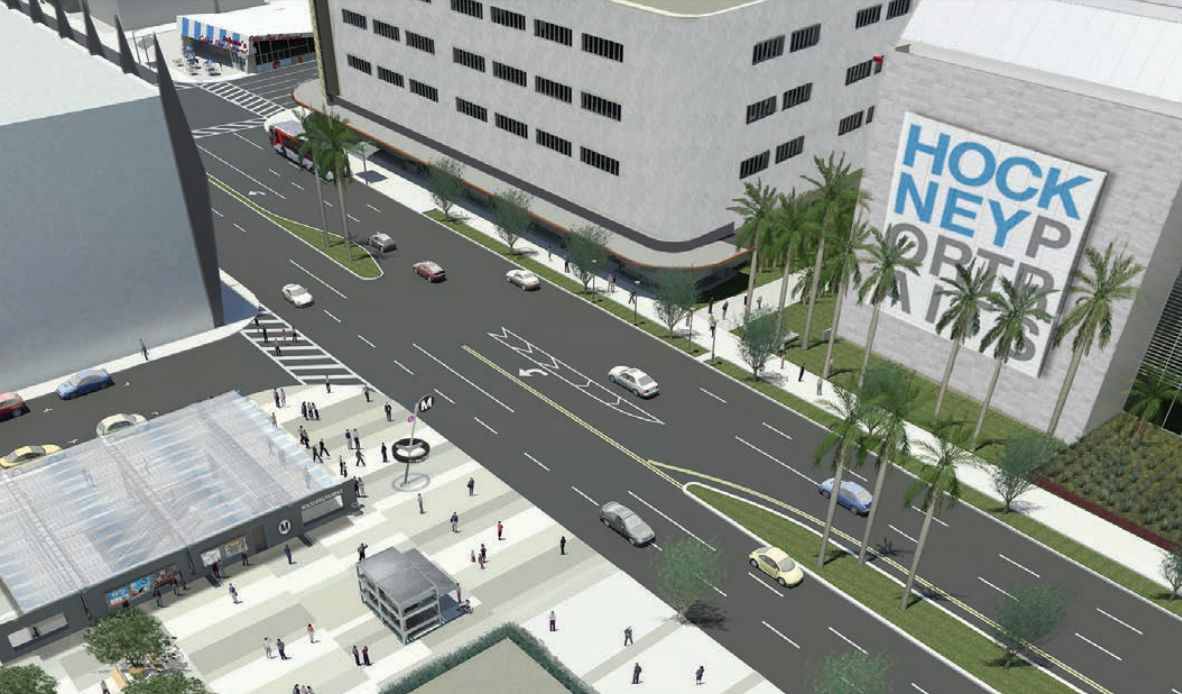 A computerized drawing showing a wide station entrance across the street from two large white buildings