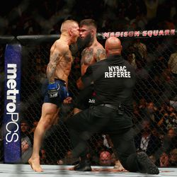After the referee ends the bout, Dillashaw screams into the face of a rising Garbrandt.