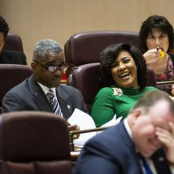 Ald. Stephanie Coleman (16th) smiles at Ald. David Moore (17th) during her first Chicago City Council meeting at City Hall, Wednesday, May 29, 2019.