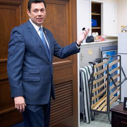 Rep. Jason Chaffetz, R-Utah, shows the closet where he keeps his famous cot. For eight years, he's slept in his office both to save money and, he says, to remind himself he lives in Utah.