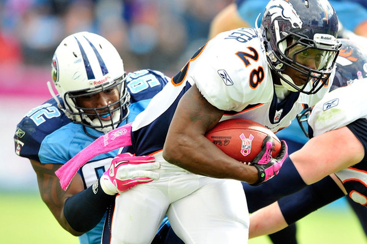 NASHVILLE TN - OCTOBER 03:  Will Witherspoon #92 of the Tennessee Titans tackles Correll Buckhalter #28 of the Denver Broncos at LP Field on October 3 2010 in Nashville Tennessee. Denver won 26-20.  (Photo by Grant Halverson/Getty Images)