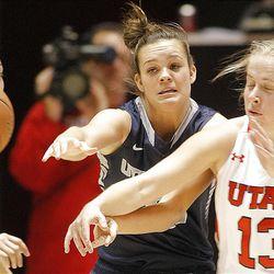 Utah's Rachel Messer, right, battles with Utah State's Makenlee Williams as Utah and Utah State play Nov. 27, 2012, in the Huntsman Center. Utah won 92-64.