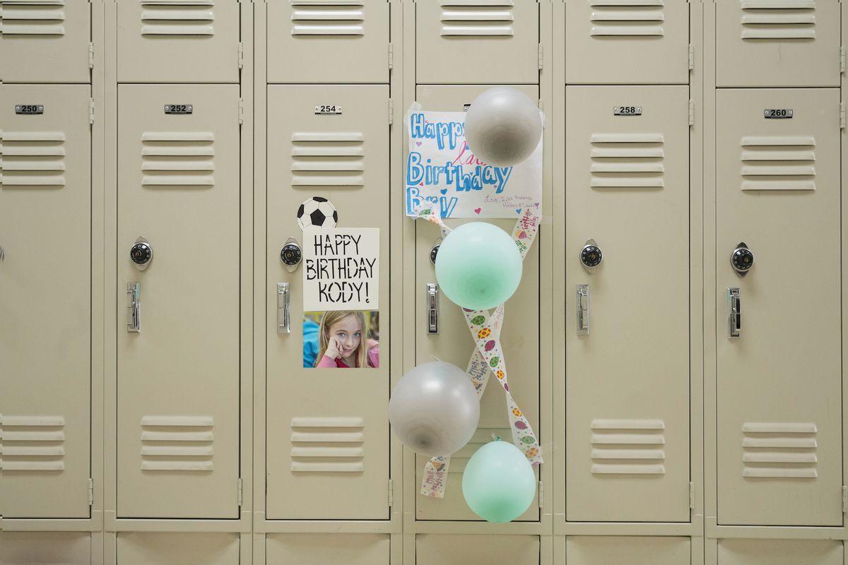 Happy birthday sign and balloons on school locker