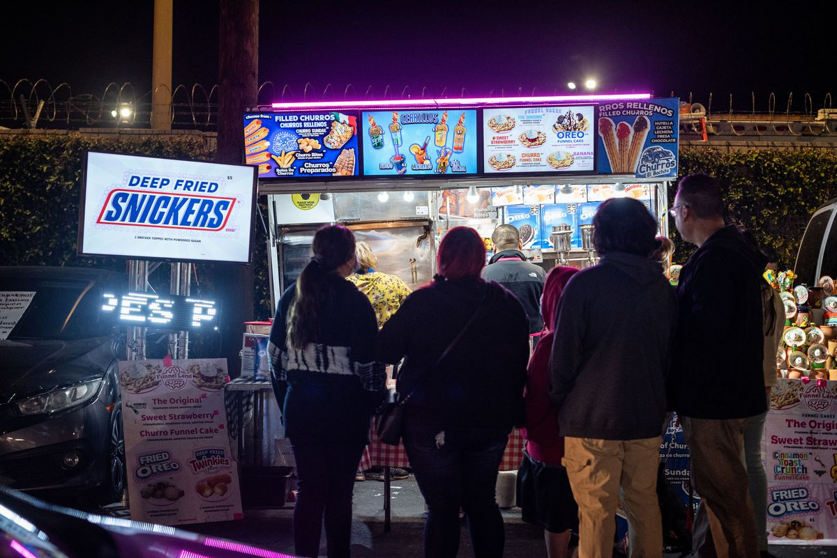 Neon lights for a night market, selling fried Snickers.