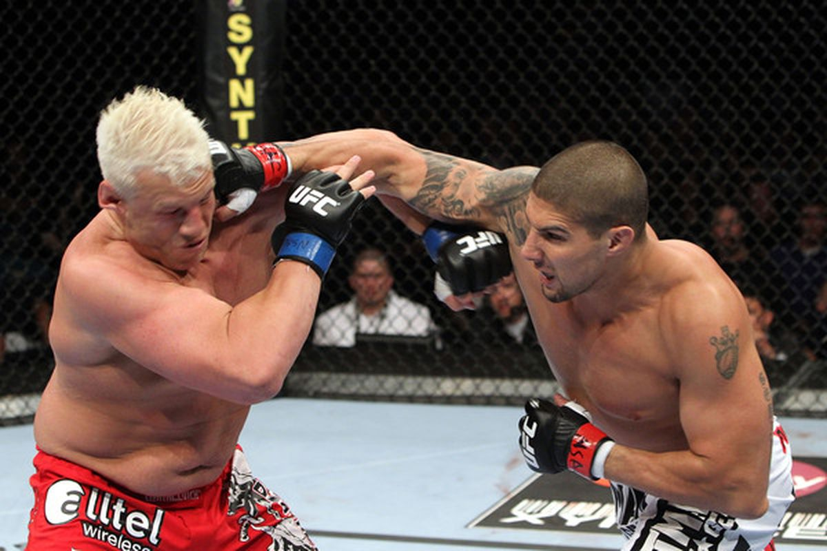 Brendan Schaub connects with a right to the face of Chris Tuchscherer at UFC 116 in July. He's expected to meet Mirko Cro Cop at UFC 128 in March.