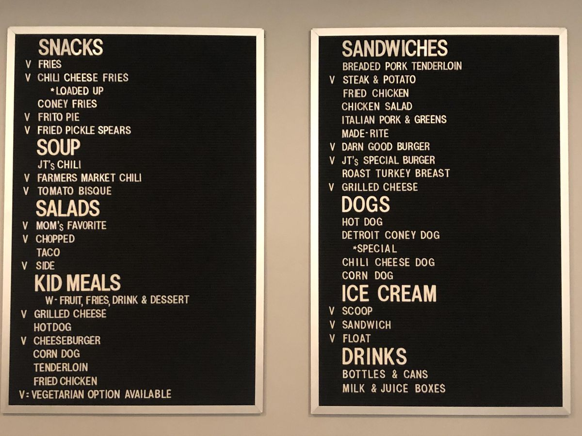 Two rectangular black menu boards with white letters.