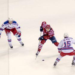 Burakovsky Tries to Skate Between Rangers
